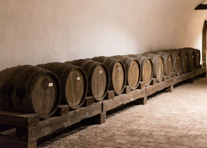 KVARELI, GEORGIA. Rows of oak barrels inside huge cellar Khareba Winery with cold underground tunnel. The tunnel was opened in 1962 for the World Wine Congress